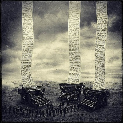 typewriters in a landscape with words floating into the sky