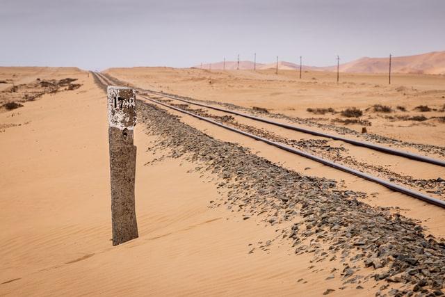 a railway track through the desert